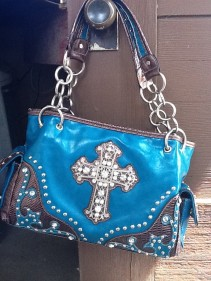 teal purse with cross