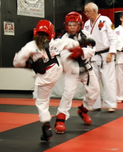 Elena Grace sparring against her brother Christian. I imagine most siblings wish they had a sanctioned space for beating on each other!