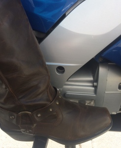 boot on motorcycle peg